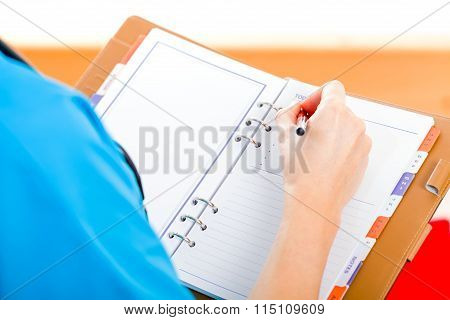 Young Doctor Writing Report