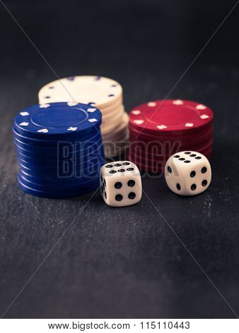 Dices And Stacks Of Poker Chips