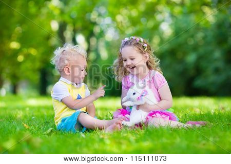 Kids Playing With Real Rabbit
