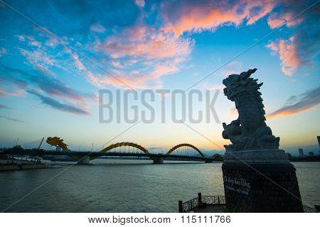 DANANG, VIETNAM - JANUARY 4, 2016: Dragon River Bridge ( Rong Bridge) in sunset in Da Nang, Vietnam.