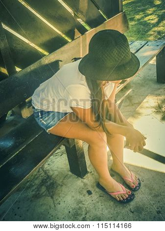 Young Woman With Black Hat Sitting At Stop Bus