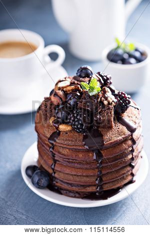 Stack of chocolate pancakes with toppings