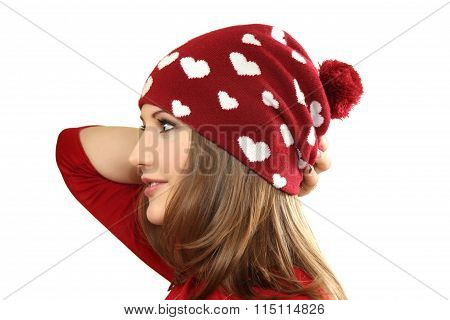 The Young Woman In A Red Dress And A Red Cap With Hearts