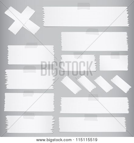 Horizontal and different size sticky tape, adhesive pieces on gray background