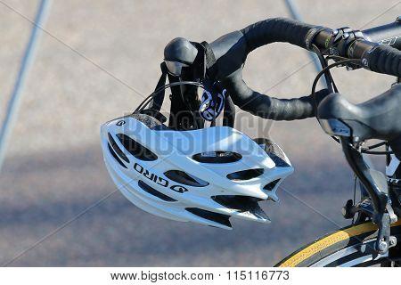 Bicycle Sports Helmet Hanging On The Handlebar
