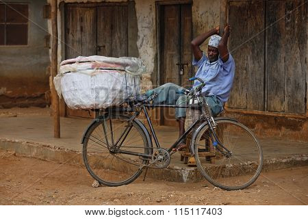 A Adult Man With A Bike