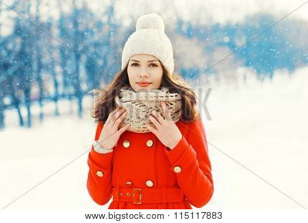 Beautiful Young Woman Wearing A Red Coat, Hat And Scarf In Winter Day