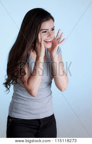 Beautiful Young Woman With Surprised Expression. Isolated On Blue Background