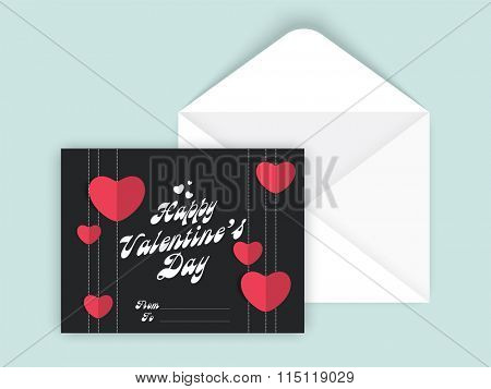 Pink hearts decorated beautiful greeting card design for Happy Valentine's Day celebration with envelope.