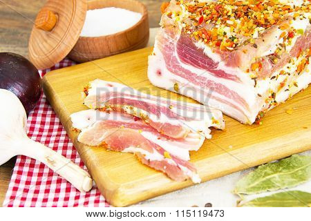 Salted Lard, Raw Pork with Spices on Wooden Cutting Board