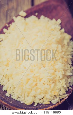 Vintage Photo Of Wooden Spoon Of Desiccated Coconut