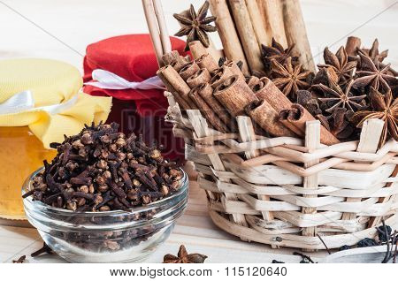Spices In A Wicker Basket And Jars With Jam