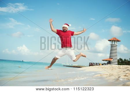 Santa Claus And Wish A Happy New Year. Funny Grandfather Frost Jumps On The Sea. Tropical Sandy Beac