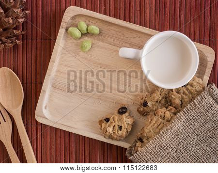 Cookies And Bean With Cup Of Milk In The Wooden Tray