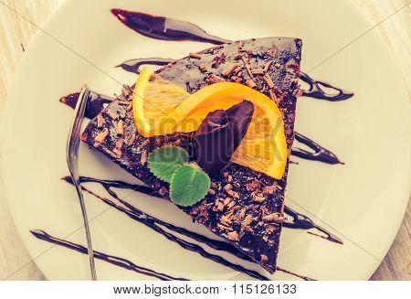 Vintage Photo Of Espresso Cake With Chocolate Glaze And Orange