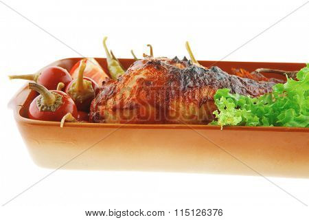 grilled pasted chicken legs with peppers and lettuce
