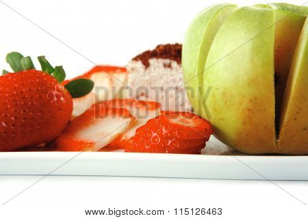 pie and fresh raw fruits on white plate