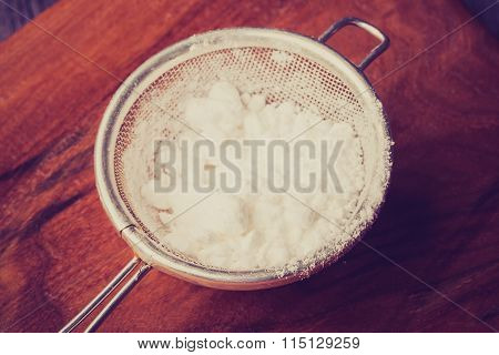 Vintage Photo Of Powdered Sugar In A Sieve