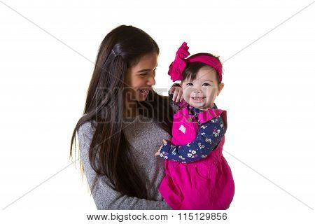 A teenager holding a baby girl