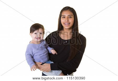 A teenager and her baby sister