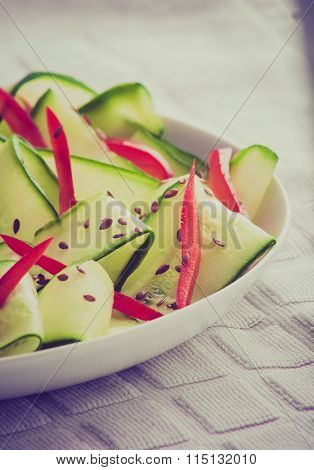 Vintage Photo Of Salad With Cucumber, Paprika And Linseed