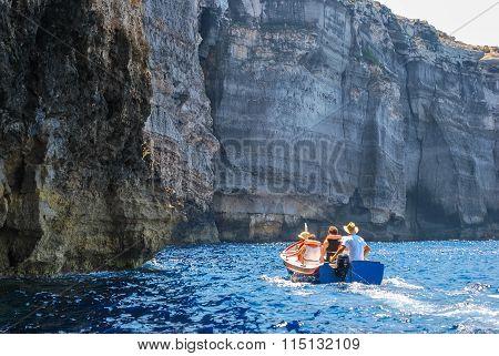 Tourists visiting Gozo Island cliffs, Malta