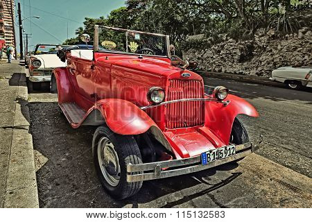 CUBA, HAVANA-JUNE 26, 2015: Classic red american car on a street in Old Havana.