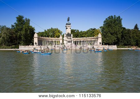Madrid, Spain - 15, June,2014: People Riding Small Boats At Parque Del Buen Retiro