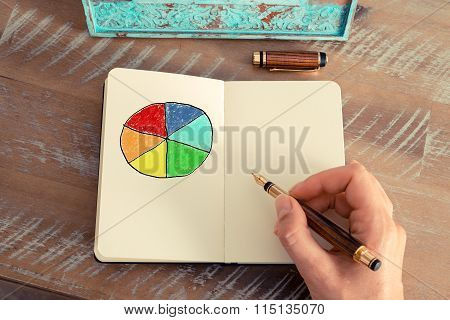 Business Woman Hand Drawing A Colourful Pie Chart