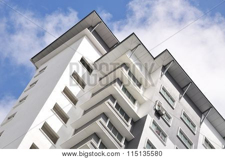 New High Luxury Apartment Building At Suburban Area With Blue Sky