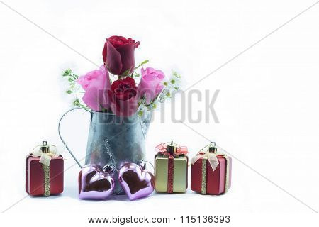 Two Pink Rose And Two Red Rose In Silver Can Vase With Present Box And Pink Heart With Green Leaf On
