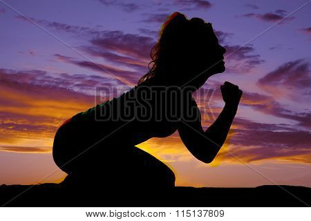 Silhouette Of A Woman On Her Knees Lean Forward
