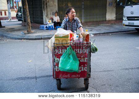 Unidentified street vendors in Hanoi ancient town, Vietnam.