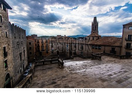 Dramatic sky over the famous steps of the Girona Cathedral