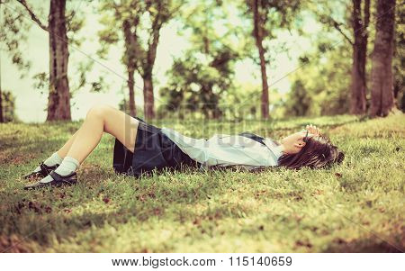 Asian Thai Female Schoolgirl Student In High School Uniform With Leather Shoes Lie Down Slee