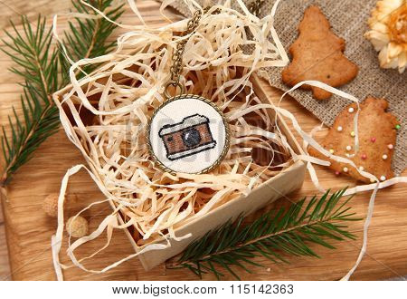 Handmade cross stitch pendant and gingerbread