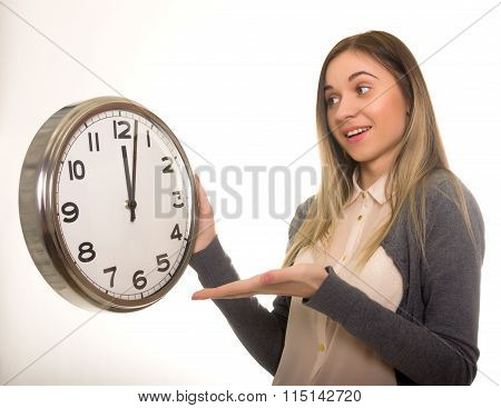 Surprise young woman looking at alarm clock, closeup portrait of beautiful europian woman, positive