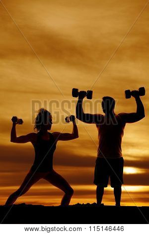Silhouette Of Man And Woman Flexing With Weights