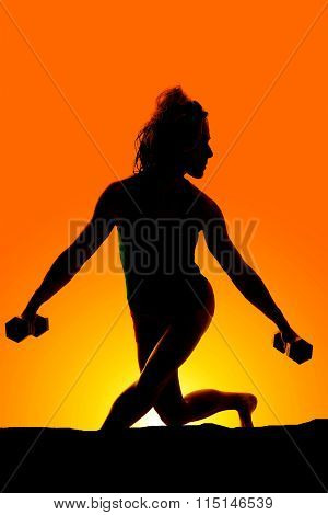 Silhouette Of Woman Cross Legs Weights Down