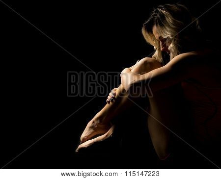 Woman Sitting Curled Up Highlightd