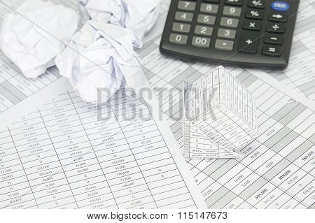 Bankruptcy Of House And Paper Ball With Calculator