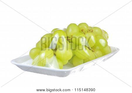 Soft Focus Of Bunch Green Grapes Covered By Food Plastic To Maintain Fresh And Cleanliness Isolated