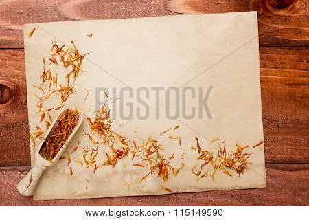 Saffron Petals On An Old Piece Of Paper