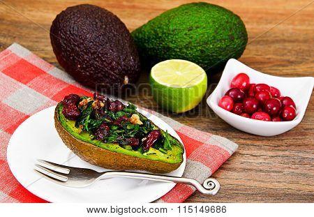 Avocado salad with herbs: dill, parsley, cilantro, nuts