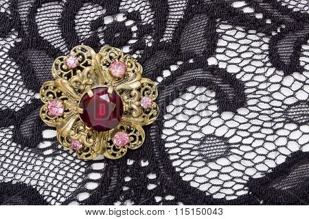 Brooch Round Shape With Large Red Rocks