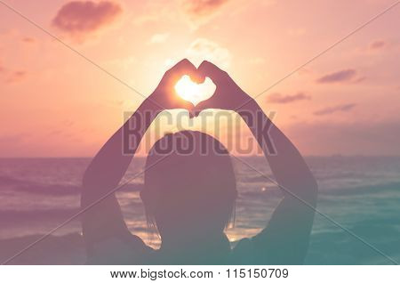 Love Shape Hand Silhouette In Sunset Or Dunrise Period. With Pantone Color Process