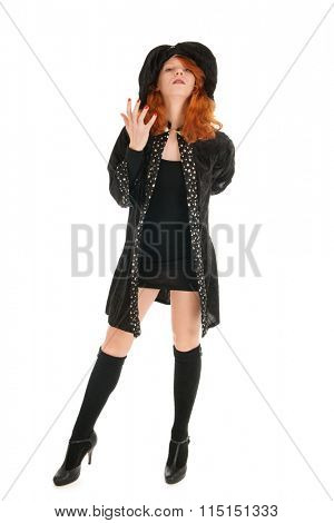 Young woman with red hair as evil witch for halloween isolated over white background