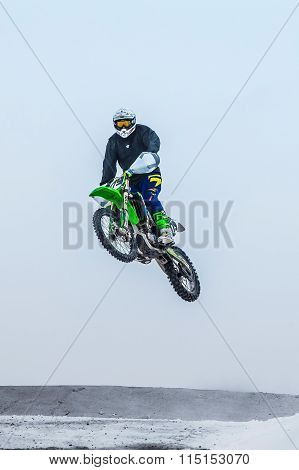 high jump athlete on a motorcycle