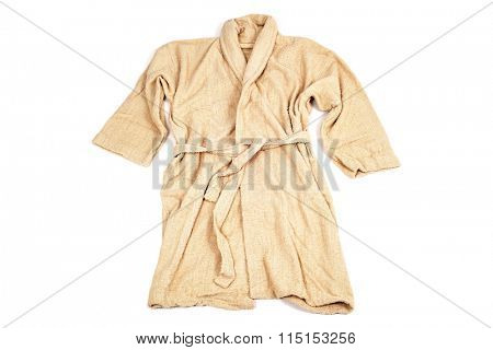 a terrycloth bathrobe in salmon color on a white background
