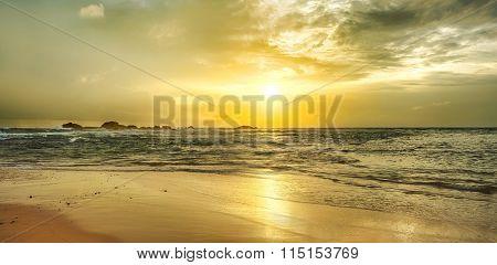 Golden sunset over the sea. Sri Lanka. Panorama